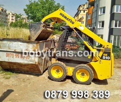 Товарене на строителни отпадъци в контейнер